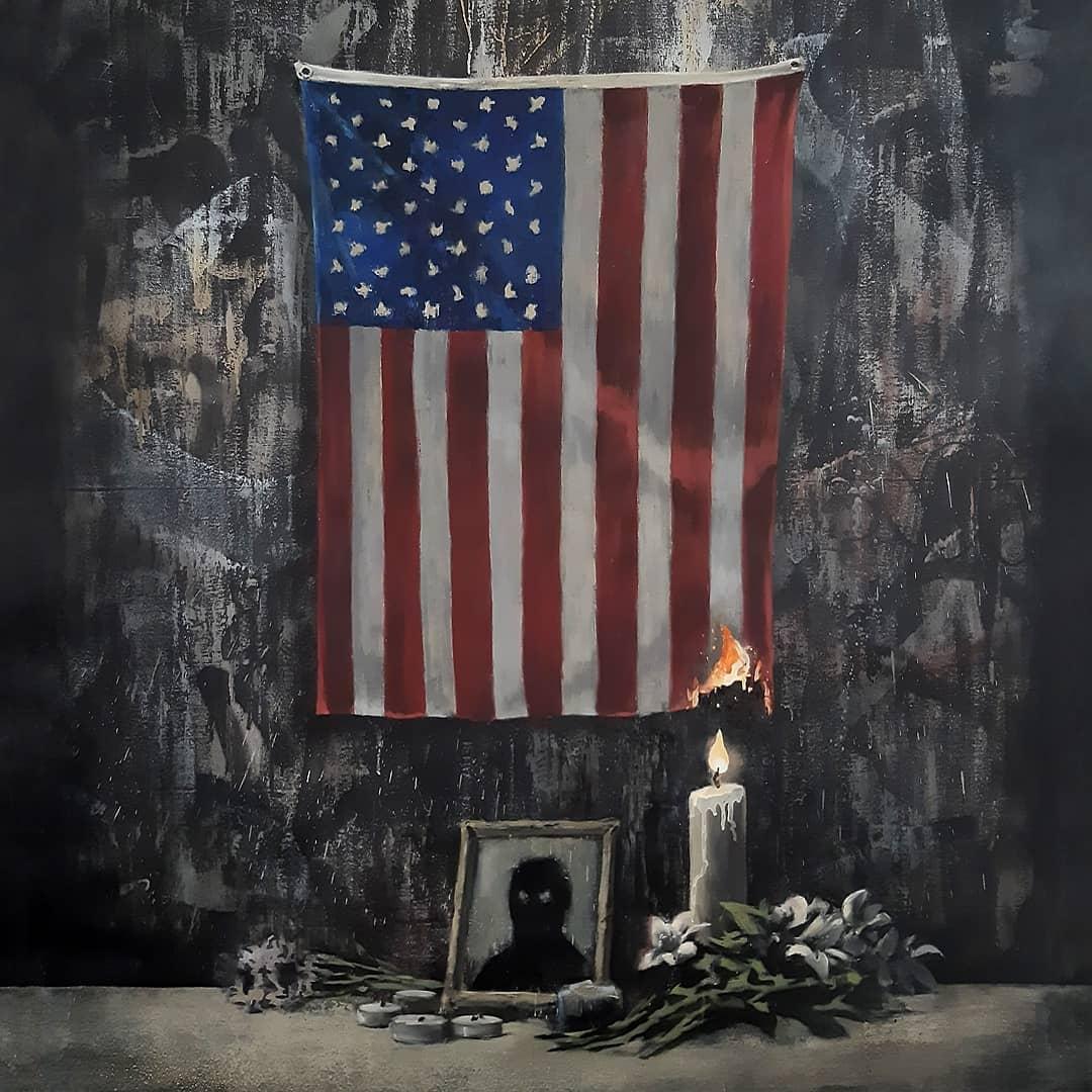 Banksy enciende la bandera estadounidense en una nueva pieza inspirada por el movimiento Black Lives Matter